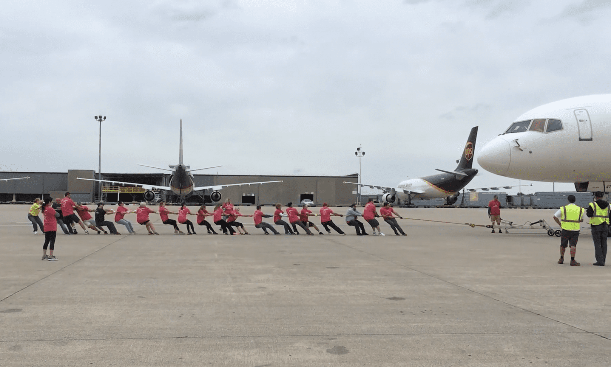Slingshot Competes in Plane Pull, Raises Money for SOKY